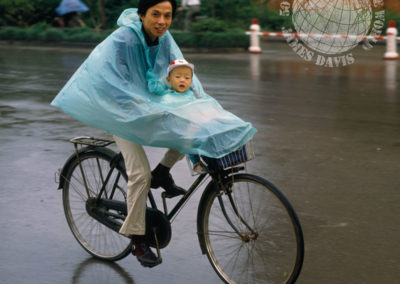 Father and baby cycling, China